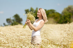 Young girl with daisies Royalty Free Stock Photography