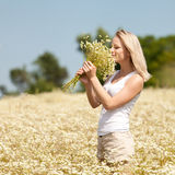 Young girl with daisies Royalty Free Stock Photos