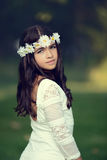 Young girl with daisy chain headband Royalty Free Stock Image
