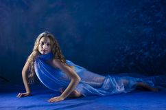 Young girl dance in blue costume. Royalty Free Stock Image