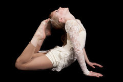 Young girl dance feet touch head. A young girl showing her flexibility in her dance clothing Stock Image