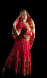 Young girl dance in red indian oriental costume Stock Images