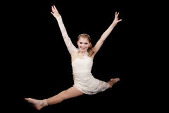 Young girl dance splits hands up. A young woman in the splits in her dance clothing in the splits Stock Image