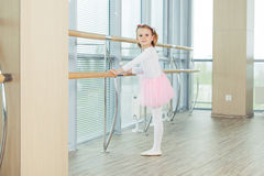 The young girl dances in a ballet tutu in the hall Stock Photography