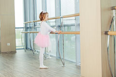 The young girl dances in a ballet tutu in the hall Stock Image