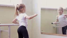 The young girl dances in a ballet tutu in the hall stock video footage