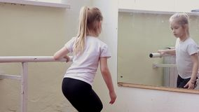 The young girl dances in a ballet tutu in the hall stock footage
