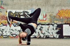 Young girl dancing breakdance on the street. Czech Republic Royalty Free Stock Images