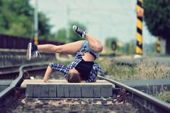 Young girl dancing breakdance on the street Stock Photos