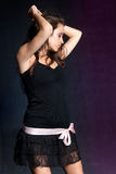 Young girl dancing at disco. Blue and purple Stock Photo