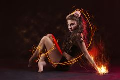 Young girl dancing with fire Stock Image