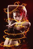 Young girl dancing with fire Royalty Free Stock Photo