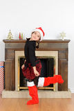 Young girl dancing in front of fireplace Stock Photo