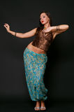 Young girl dancing in indian clothes. Over black Stock Image
