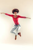 Young girl dancing, jumping. Stock Photography