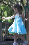 Young girl dancing in a playground. Young girl dancing in a park playground Stock Photo