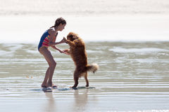 Young Girl Dancing With A Dog Stock Images