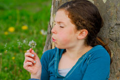 Young girl with dandelion. Royalty Free Stock Image