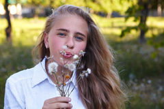 Young girl and dandelion Royalty Free Stock Photo