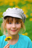 Young girl with dandelions Royalty Free Stock Photo