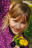 Young girl with dandelions Stock Images