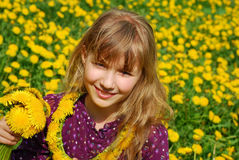 Young girl with dandelions Stock Photography