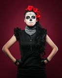 Young girl in day of the dead mask on red Royalty Free Stock Photography