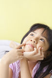 Young girl daydreaming Royalty Free Stock Images