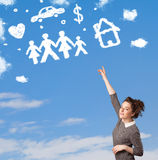 Young girl daydreaming with family and household clouds Stock Photos