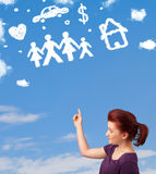 Young girl daydreaming with family and household clouds Stock Images