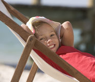 A young girl in a deck chair Stock Photo