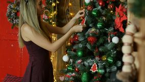 Young girl decorate Christmas tree stock video footage
