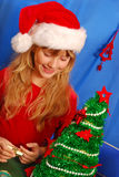 Young girl decorating christmas tree Royalty Free Stock Images