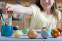 Young girl decorating Easter eggs Stock Photography
