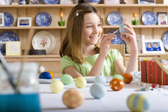Young girl decorating Easter eggs Royalty Free Stock Photos