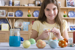 Young girl decorating Easter eggs Royalty Free Stock Photo