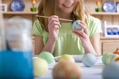 Young girl decorating Easter eggs Stock Images