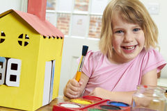 Young Girl Decorating Model House Indoors Royalty Free Stock Photos