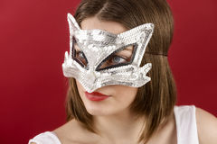 young girl in the decorative mask Royalty Free Stock Photo