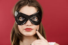 Young girl in the decorative mask Stock Image