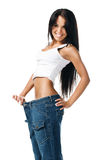 Young girl demonstrating weight loss Royalty Free Stock Images