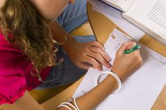Young Girl at desk in school Stock Photo