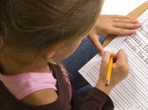 Young Girl at desk in school on white Stock Photography