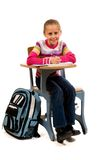 Young Girl at desk in school on white Royalty Free Stock Images
