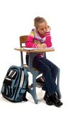 Young Girl at desk in school on white Stock Images