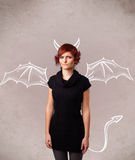 Young girl with devil horns and wings drawing Royalty Free Stock Images
