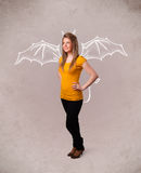 Young girl with devil horns and wings drawing Stock Photos