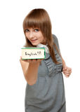 Young girl with dictionary english Royalty Free Stock Images