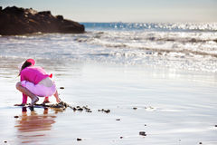 Young girl digging in the sand Royalty Free Stock Photos