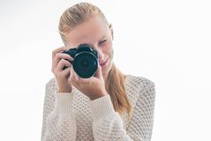 Young girl with digital camera, taking a picture. Isolated on white Royalty Free Stock Image